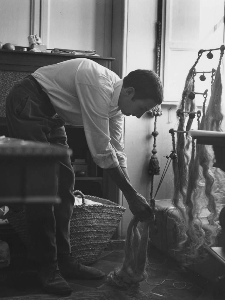 Monochrome Photo of Rauschenberg at Work