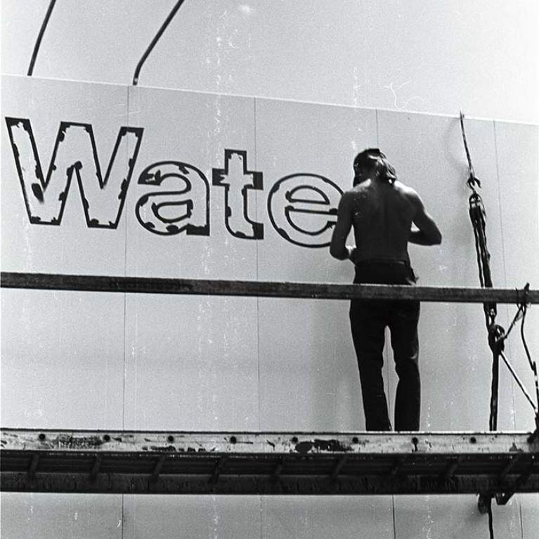 Man works on Climate Change Billboard